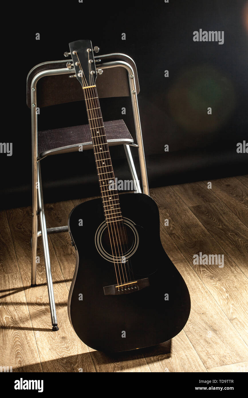 Acoustic Guitar in black and white the music room - Stock Image