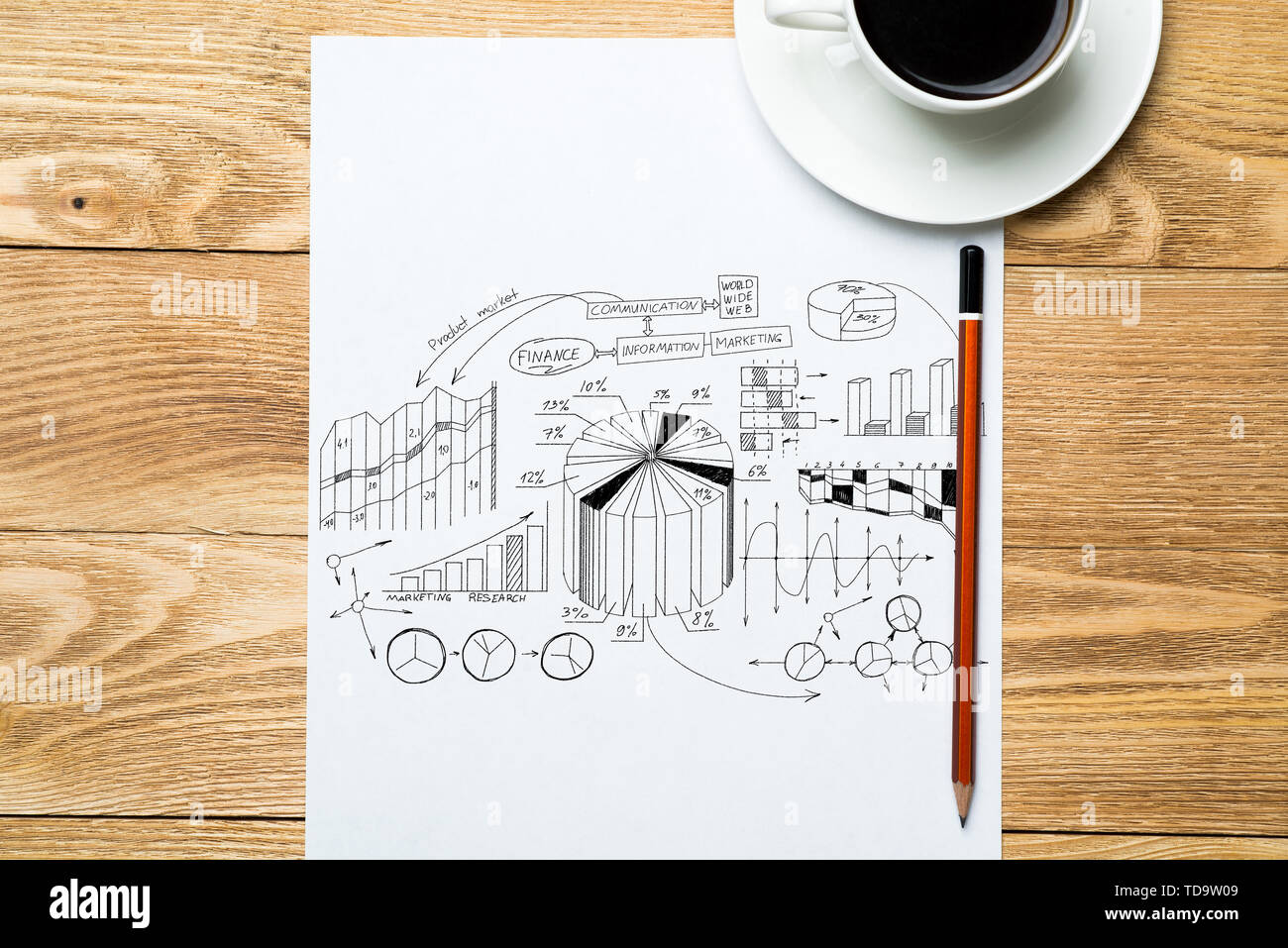 Notepad with idea sketches coffee cup and pencil on wooden table - Stock Image