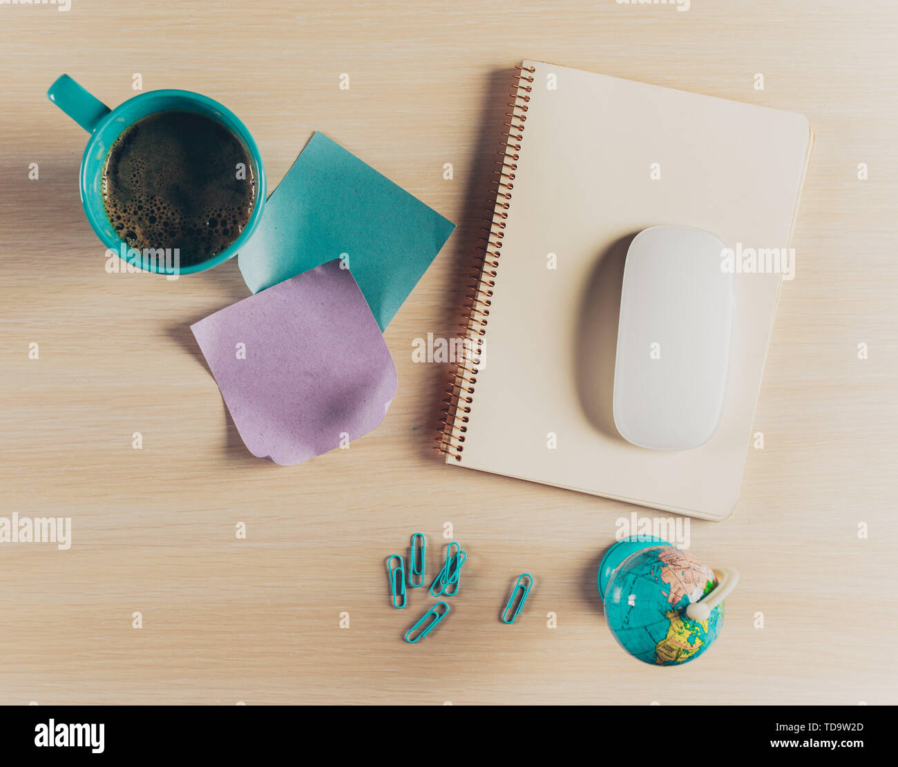 Top view workspace with blank notebook and pen on wooden table - Stock Image