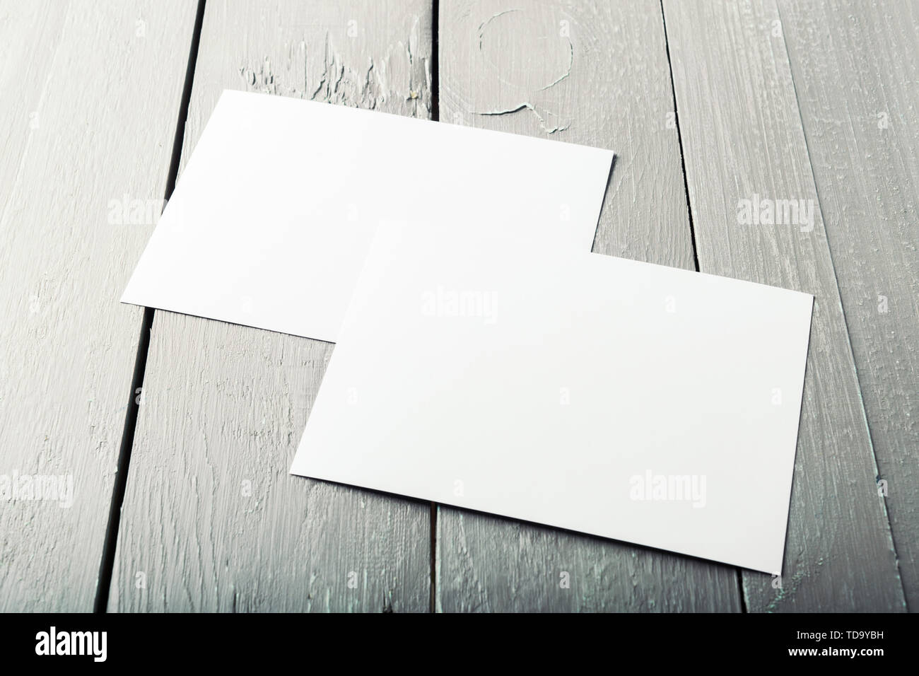 blank business cards on a wooden background - Stock Image