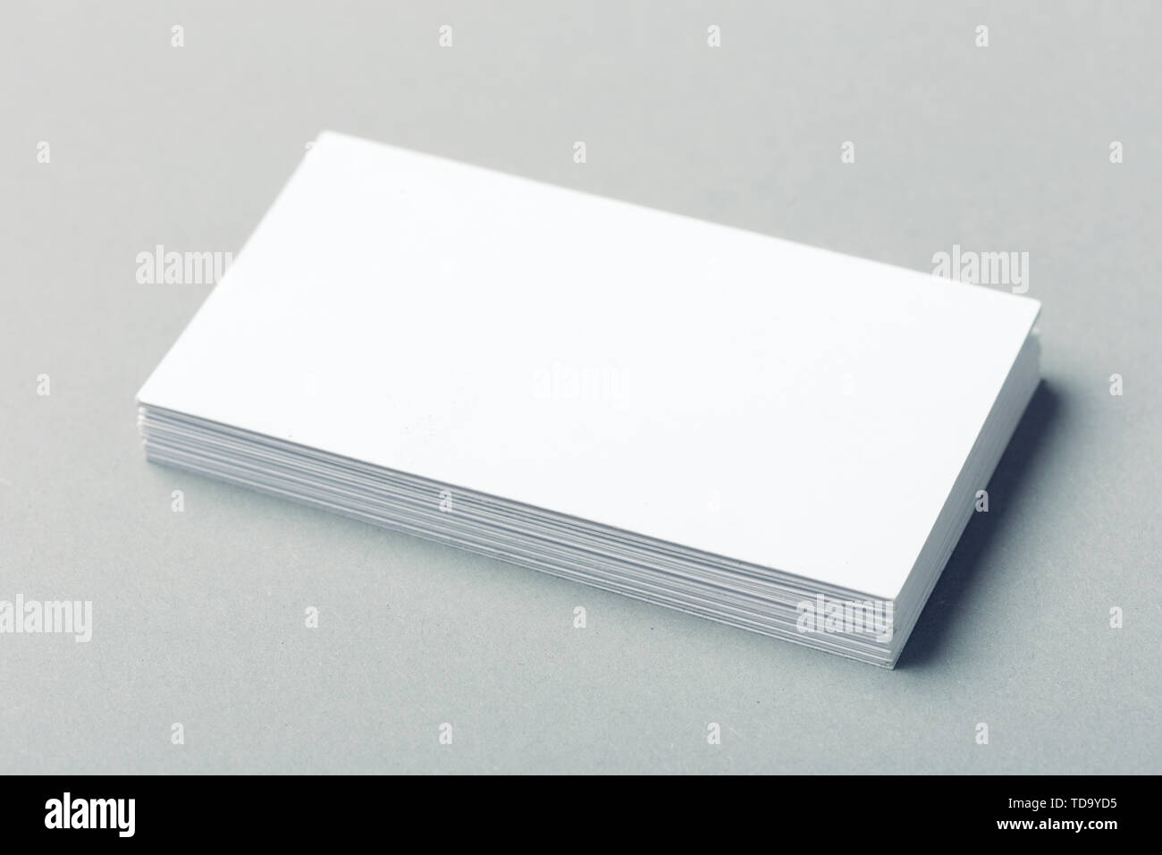blank business cards on grey background - Stock Image