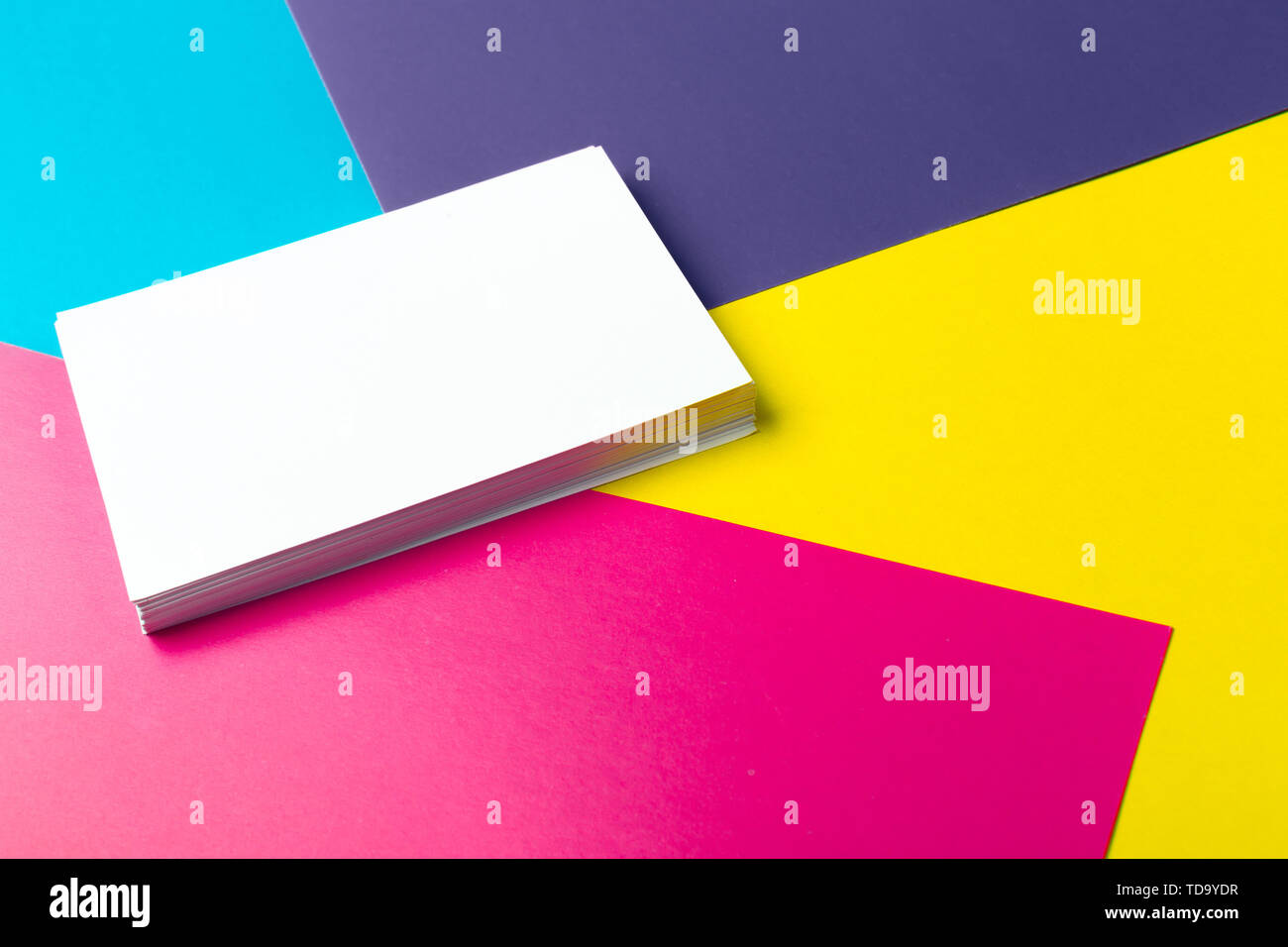 Business card blank over colorful abstract background. - Stock Image
