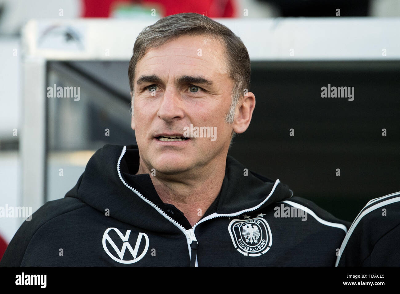 Preview UEFA Under21 European Championship in Italy/SanMarino from 16-30.06 2019. Stock Photo: coach Stefan KUNTZ (GER) sings the national anthem with, singing, half-length, Soccer Laender, U21, Friendly Match, Germany (GER) - France (FRA) 2: 2, on 21.03.2019 in Essen/Germany. å | usage worldwide - Stock Image