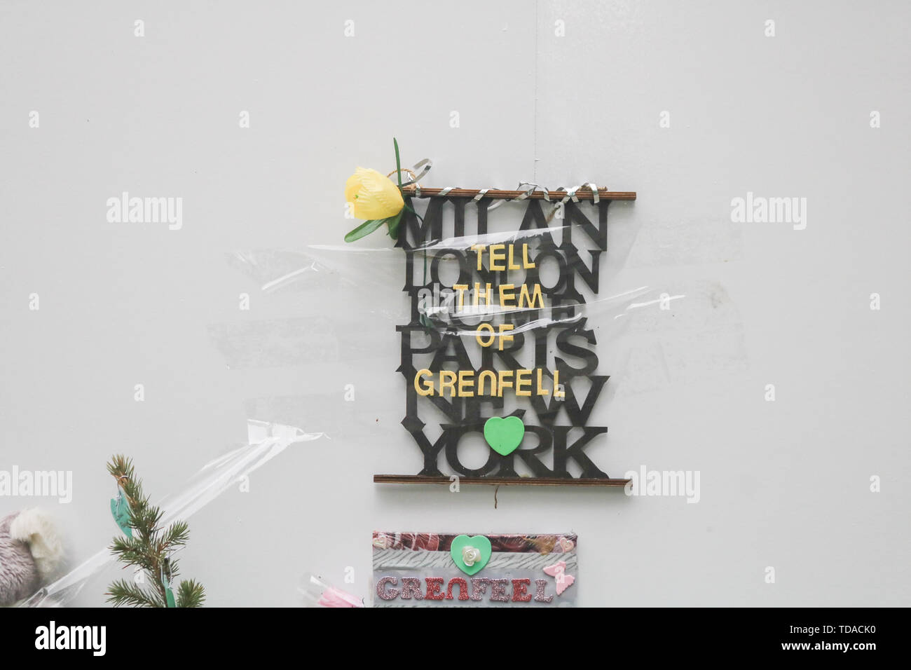 London, UK. 13th June, 2019. A message at the memorial to the Grenfell fire victims on the second anniversary of the devastating inferno fire which in the residential tower block in West London on 14 June 2017 Credit: amer ghazzal/Alamy Live News - Stock Image