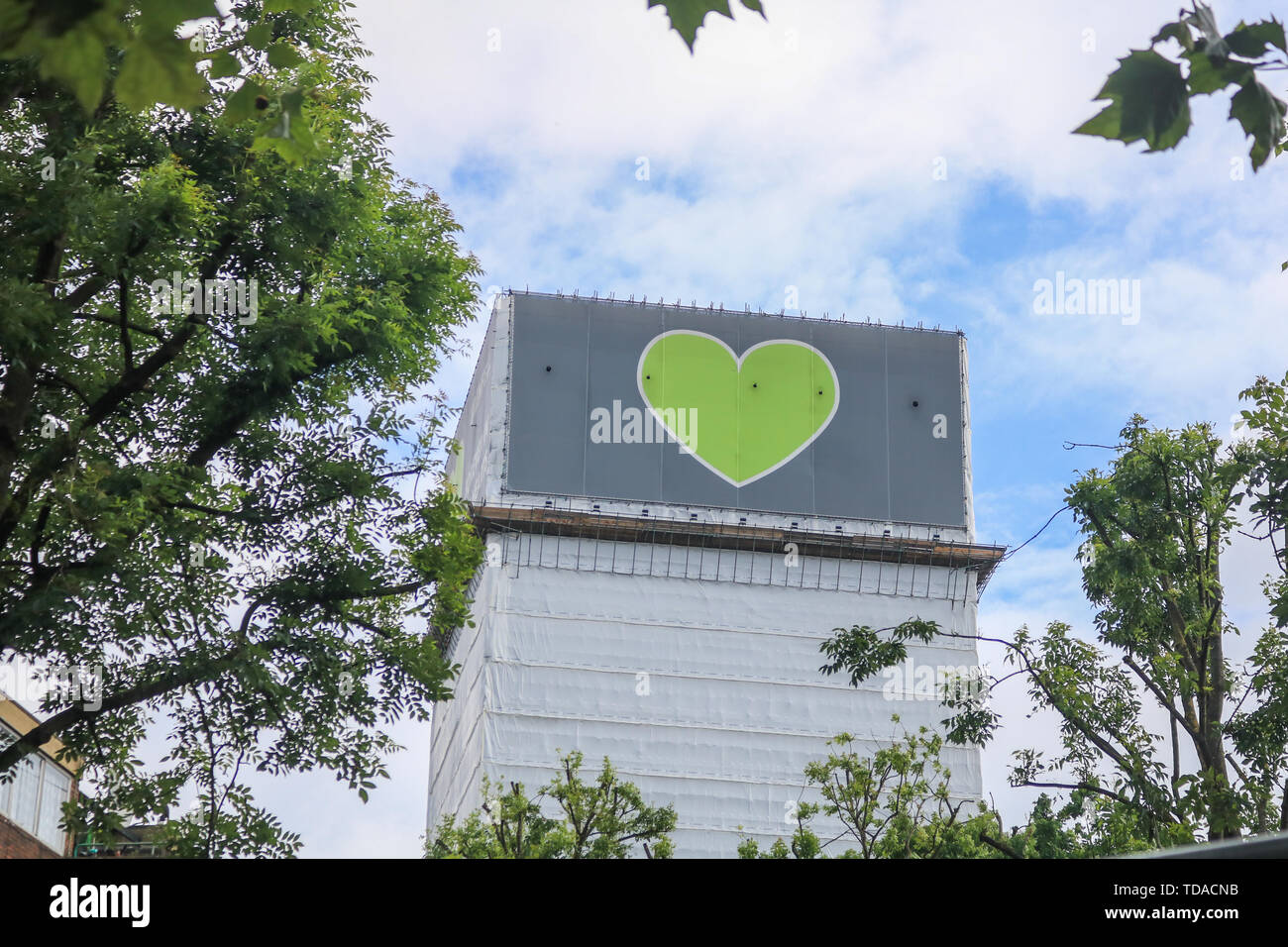 London, UK. 13th June, 2019. Grenfell tower covered in white tarpaulin on the second anniversary of the devastating inferno fire which in the residential tower block in West London on 14 June 2019 Credit: amer ghazzal/Alamy Live News - Stock Image