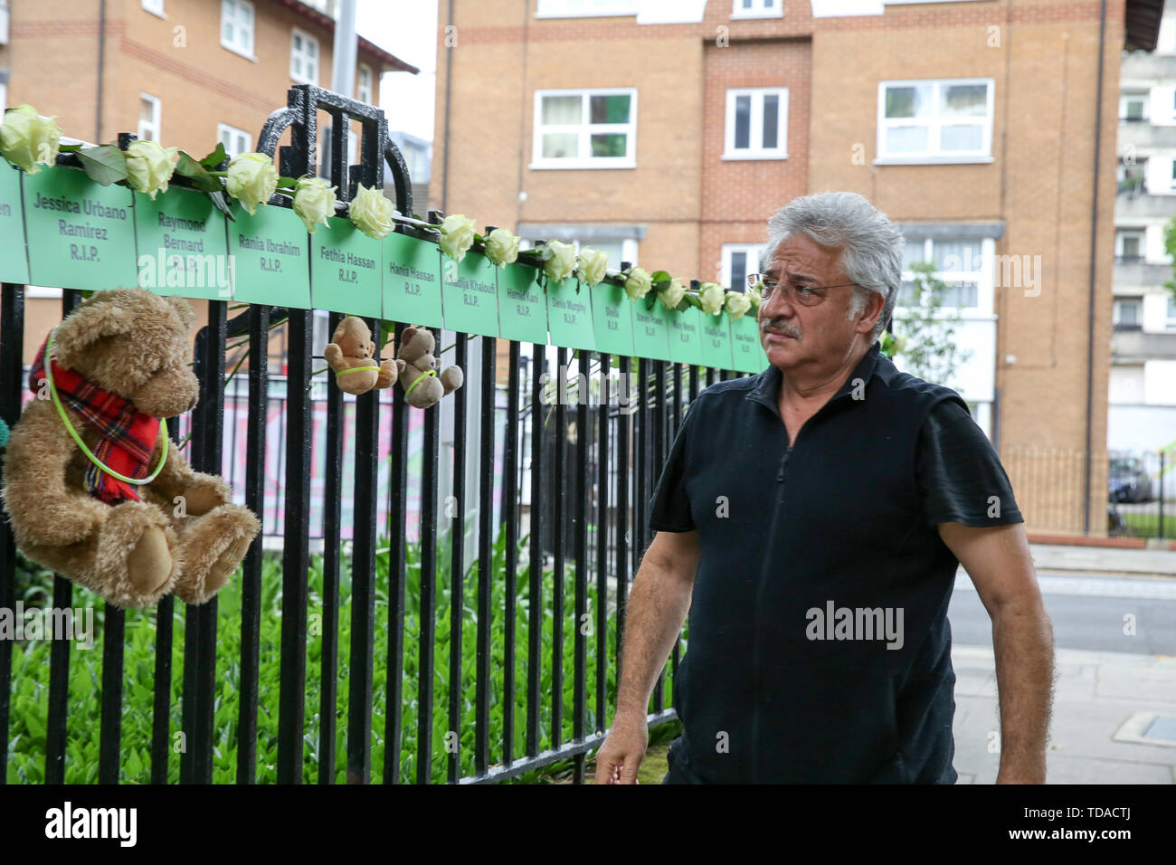 North Kensington, West London. UK 14 Jun 2019 - The names of people who lost their lives, hung from railings on a block of flats to commemorate the second anniversary of the Grenfell Tower fire. On 14 June 2017, just before 1:00Êam a fire broke out in the kitchen of the fourth floor flat at the 24-storey residential tower block in North Kensington, West London, which took the lives of 72 people. More than 70 others were injured and 223 people escaped.  Credit: Dinendra Haria/Alamy Live News - Stock Image