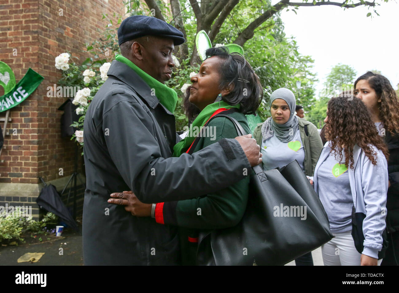 North Kensington, West London. UK 14 Jun 2019 - Survivors, family and friends of the victims arrive at St Helen's Church to commemorate the second anniversary of the Grenfell Tower fire service. On 14 June 2017, just before 1:00Êam a fire broke out in the kitchen of the fourth floor flat at the 24-storey residential tower block in North Kensington, West London, which took the lives of 72 people. More than 70 others were injured and 223 people escaped.  Credit: Dinendra Haria/Alamy Live News - Stock Image