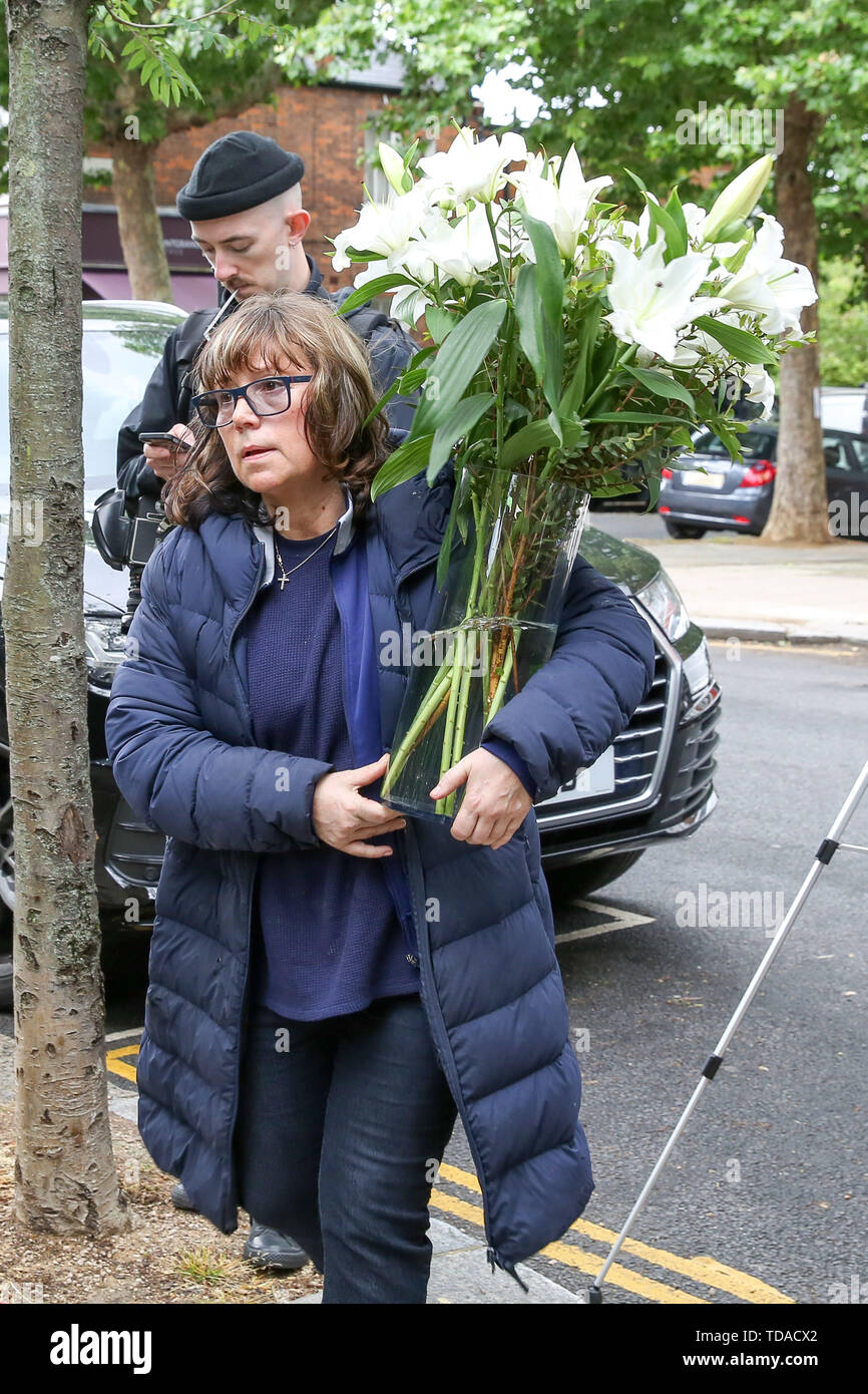 North Kensington, West London. UK 14 Jun 2019 - A florist brings floral tributes at St Helen's Church to commemorate the second anniversary of the Grenfell Tower fire service. On 14 June 2017, just before 1:00Êam a fire broke out in the kitchen of the fourth floor flat at the 24-storey residential tower block in North Kensington, West London, which took the lives of 72 people. More than 70 others were injured and 223 people escaped.  Credit: Dinendra Haria/Alamy Live News - Stock Image