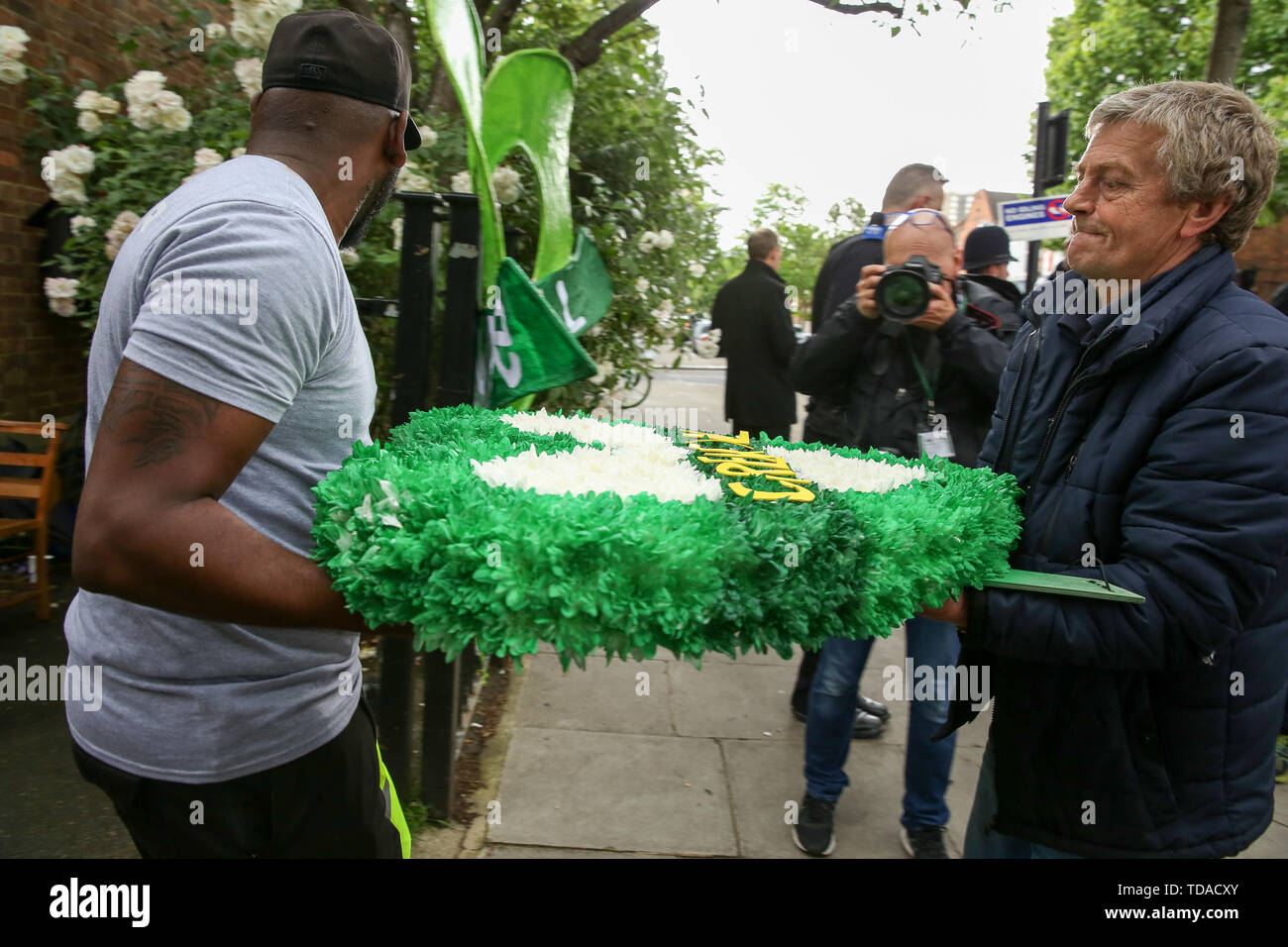 North Kensington, West London. UK 14 Jun 2019 - Florists brings floral tributes at St Helen's Church to commemorate the second anniversary of the Grenfell Tower fire service. On 14 June 2017, just before 1:00Êam a fire broke out in the kitchen of the fourth floor flat at the 24-storey residential tower block in North Kensington, West London, which took the lives of 72 people. More than 70 others were injured and 223 people escaped.  Credit: Dinendra Haria/Alamy Live News - Stock Image