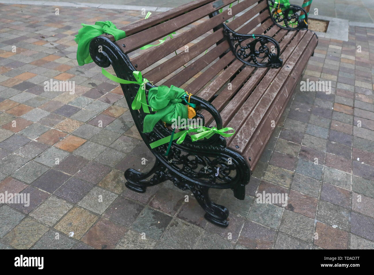 London, UK. 13th June, 2019. A public bench with green ribbons to commemorate the second anniversary of the devastating inferno fire which in the residential tower block in West London on 14 June 2017 Credit: amer ghazzal/Alamy Live News - Stock Image