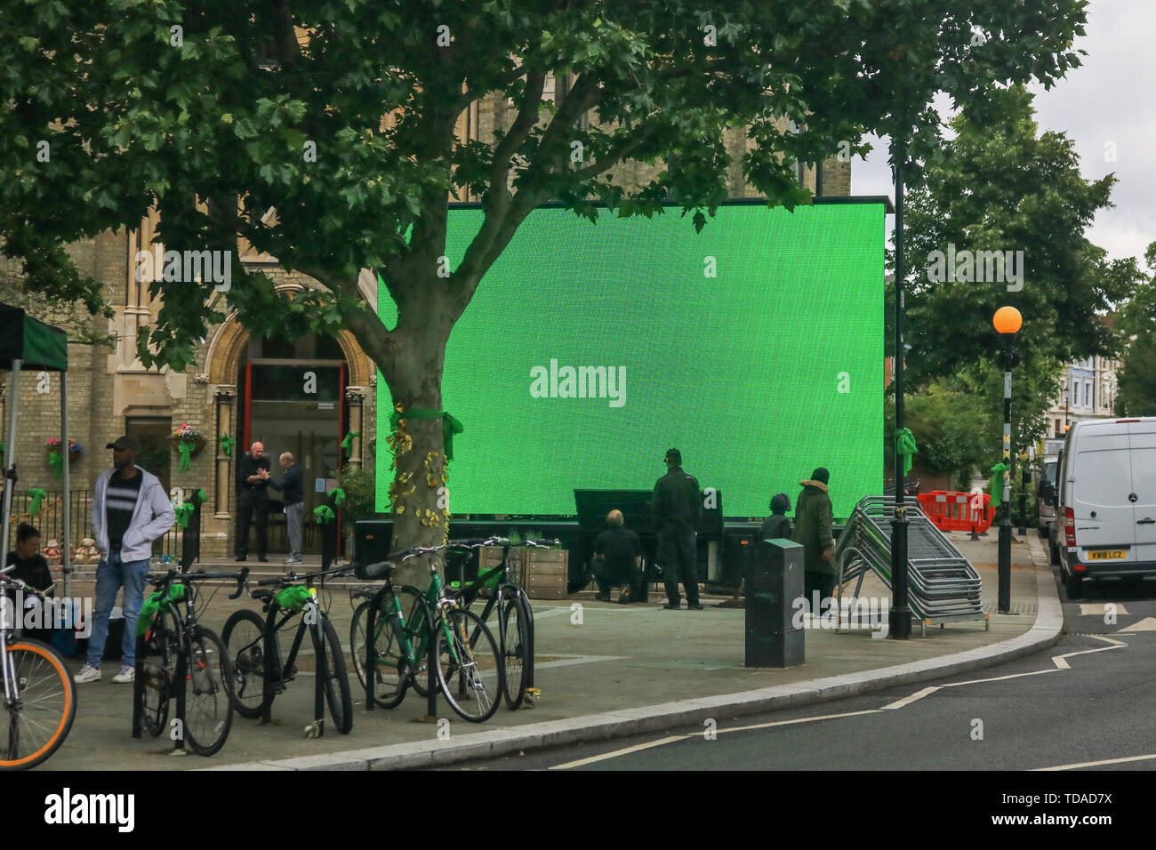 London, UK. 13th June, 2019. A large screen projecting green colour on the second anniversary of the devastating inferno fire which in the residential tower block in West London within the borough of Kensington and Chelsea on 14 June 2017 Credit: amer ghazzal/Alamy Live News - Stock Image