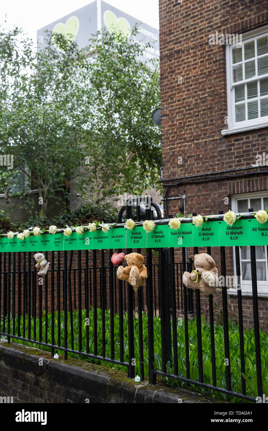 London, UK. 14 June, 2019. Tributes to those who lost their lives in the Grenfell Tower fire close to the tower on the second anniversary of the tragedy on 14th June 2017 which claimed the lives of 72 people and injured over 70 more. Credit: Mark Kerrison/Alamy Live News - Stock Image