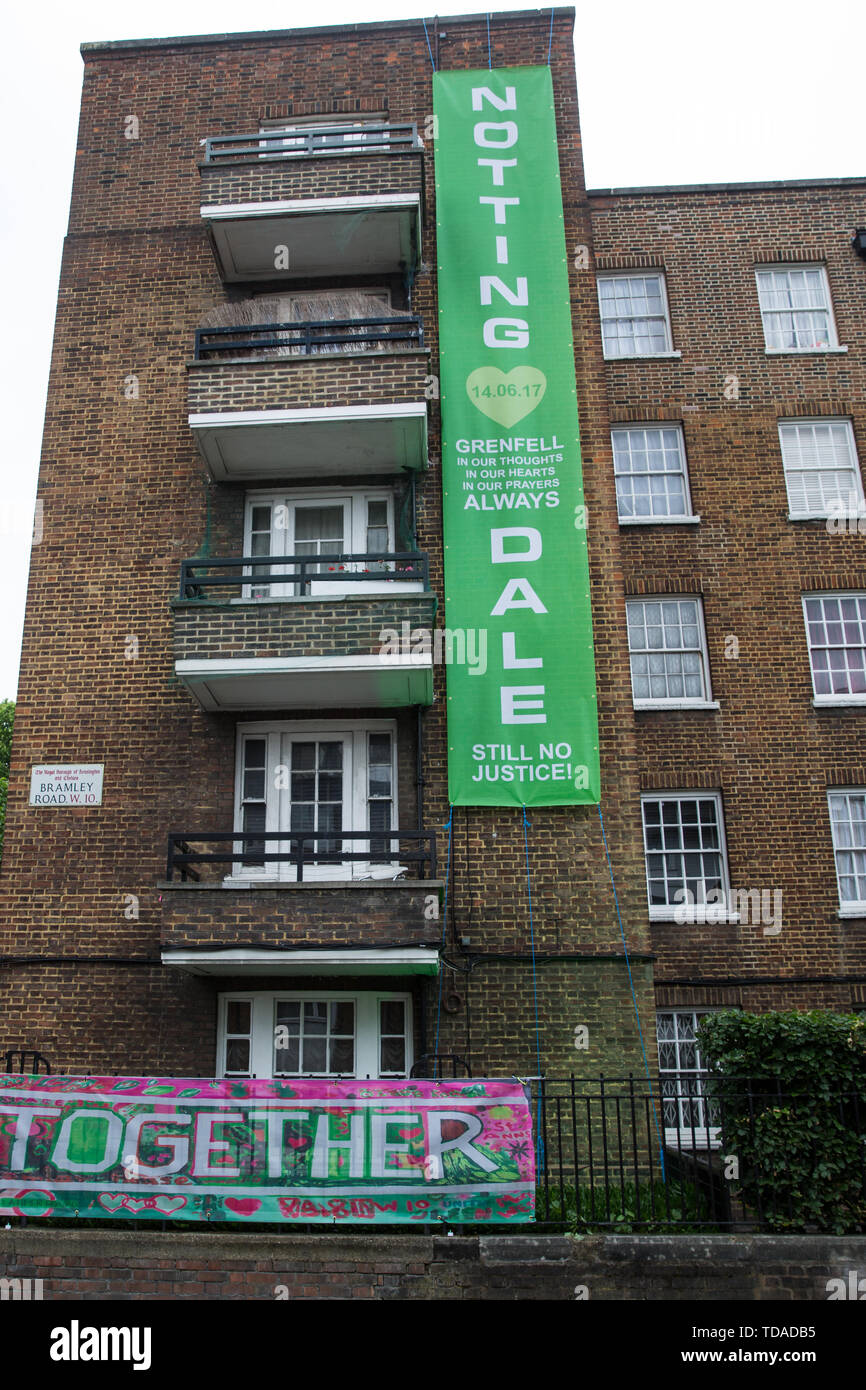 London, UK. 14 June, 2019. A banner pays tribute to those who lost their lives in the Grenfell Tower fire close to the tower on the second anniversary of the tragedy on 14th June 2017 which claimed the lives of 72 people and injured over 70 more. Credit: Mark Kerrison/Alamy Live News - Stock Image