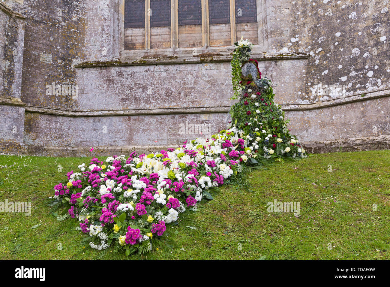 Christchurch, Dorset UK. 14th Jun 2019. The 2nd annual FlowerFest takes place in the historic town of Christchurch, supporting MacMillan Caring Locally Brick by Brick appeal. We all need TLC and Together we Link the Community particularly with projects floral, nature or garden related.  Today is the first day of the 3 day event where visitors can follow a floral trail around the town. Credit: Carolyn Jenkins/Alamy Live News - Stock Image