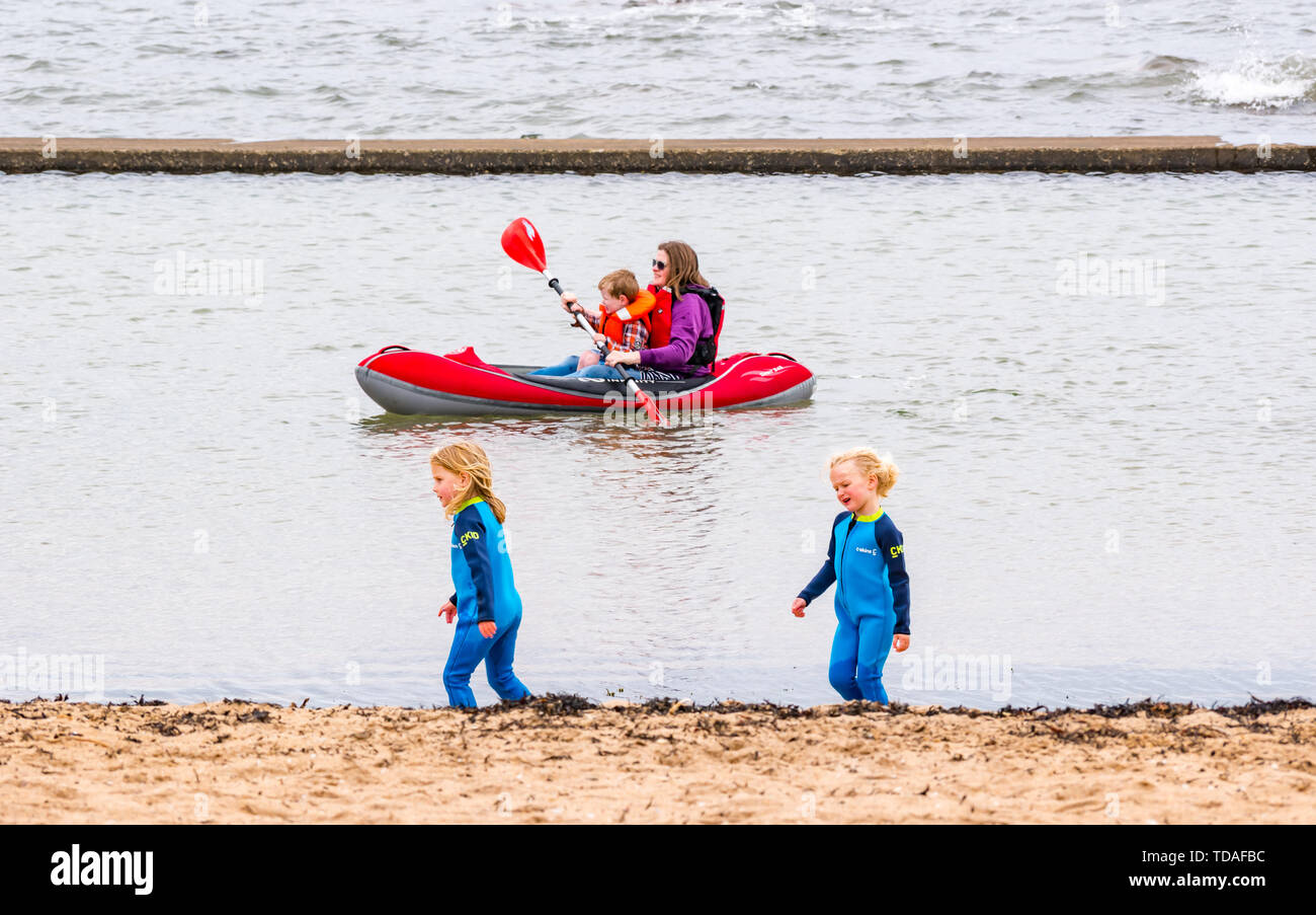 North Berwick, East Lothian, Scotland, United Kingdom, 14th June 2019. UK Weather: After East Lothian suffered heavy rain the last few days, the weather has brightened, and people enjoy the outdoor pursuits in the seaside town. A family and children enjoy the tidal bathing pool at Milsey Bay.  Credit: Sally AndersonCredit: Sally Anderson Credit: Sally Anderson/Alamy Live News - Stock Image