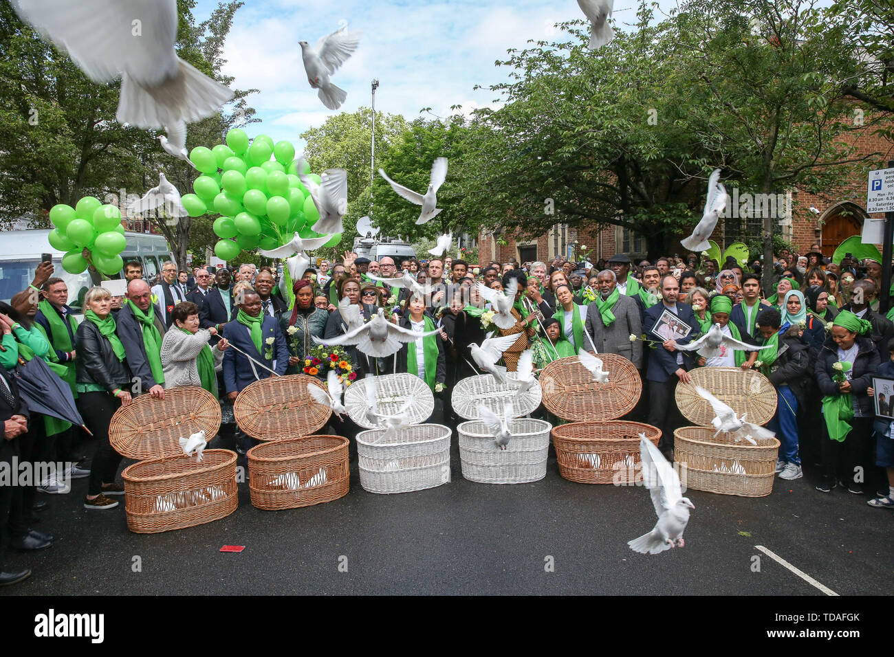 North Kensington, West London. UK 14 Jun 2019 - 72 white doves are released by survivors, family and friends of the victims following a service is held at St Helen's Church in North Kensington to commemorate the second anniversary of the Grenfell Tower fire. On 14 June 2017, just before 1:00Êam a fire broke out in the kitchen of the fourth floor flat at the 24-storey residential tower block in North Kensington, West London, which took the lives of 72 people. More than 70 others were injured and 223 people escaped.  Credit: Dinendra Haria/Alamy Live News - Stock Image