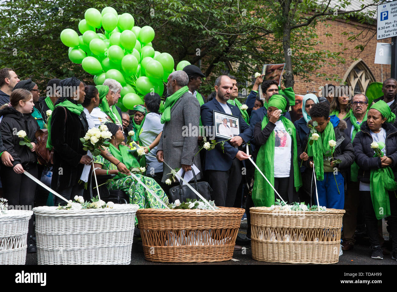 London, UK. 14 June, 2019. Family members prepare to release doves of peace following a memorial service at St Helen's Church to mark the second anniversary of the Grenfell Tower fire on 14th June 2017 in which at least 72 people died and over 70 were injured. Credit: Mark Kerrison/Alamy Live News - Stock Image