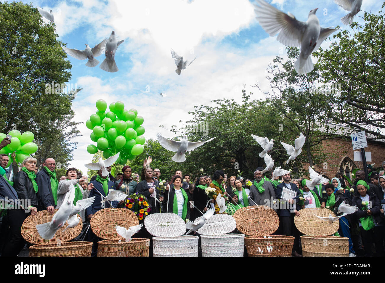 London, UK. 14 June, 2019. Family members release doves of peace following a memorial service at St Helen's Church to mark the second anniversary of the Grenfell Tower fire on 14th June 2017 in which at least 72 people died and over 70 were injured. Credit: Mark Kerrison/Alamy Live News - Stock Image