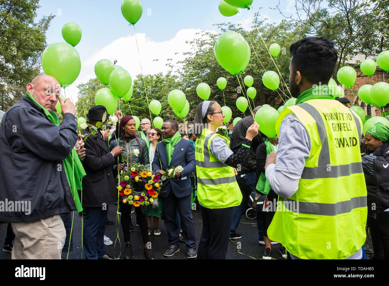 London, UK. 14 June, 2019. Family members prepare to release green balloons following a memorial service at St Helen's Church to mark the second anniversary of the Grenfell Tower fire on 14th June 2017 in which at least 72 people died and over 70 were injured. Credit: Mark Kerrison/Alamy Live News - Stock Image