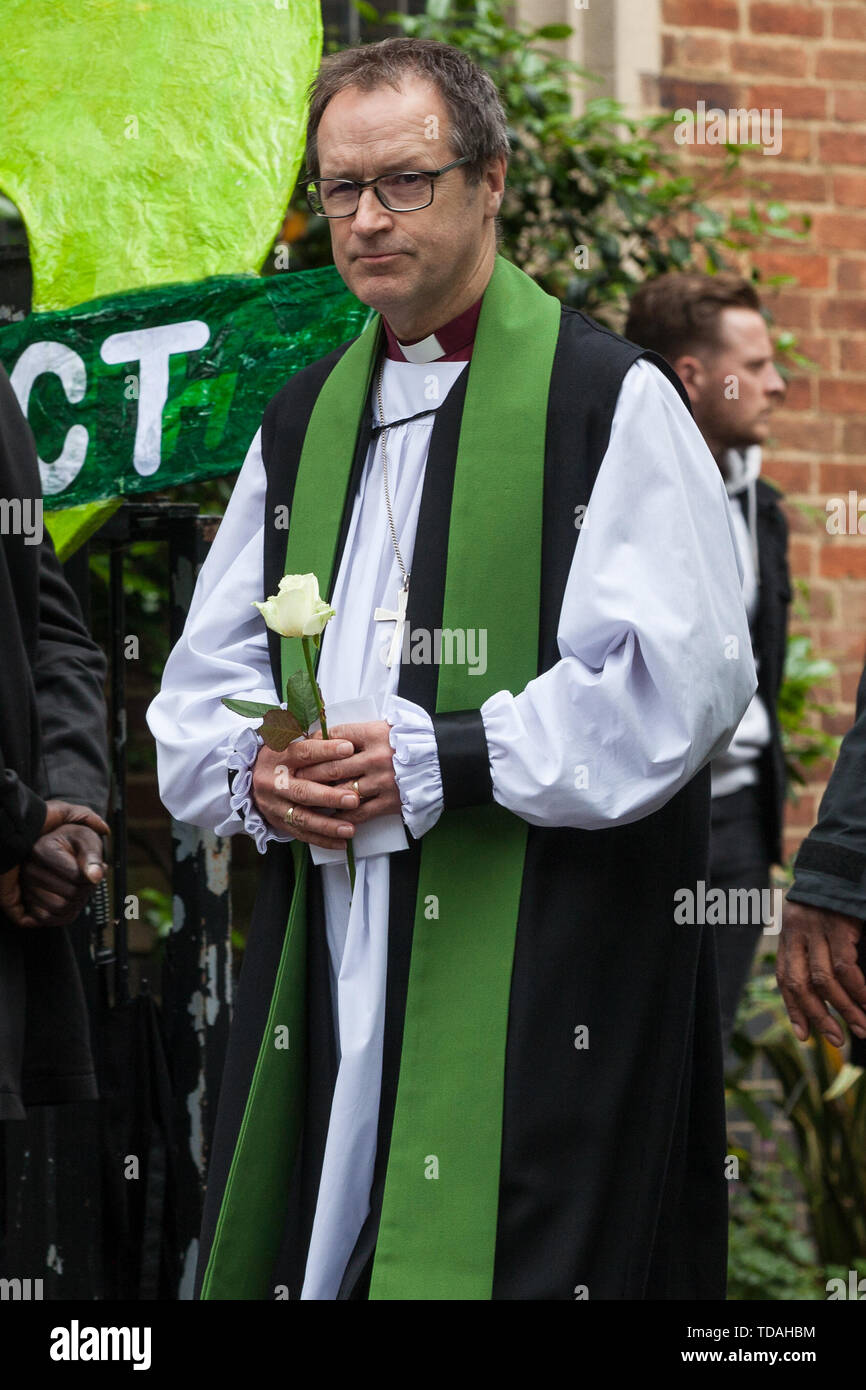 London, UK. 14 June, 2019. Dr Graham Tomlin, Bishop of Kensington, joins family members to release doves of peace following a memorial service at St Helen's Church to mark the second anniversary of the Grenfell Tower fire on 14th June 2017 in which at least 72 people died and over 70 were injured. Credit: Mark Kerrison/Alamy Live News - Stock Image