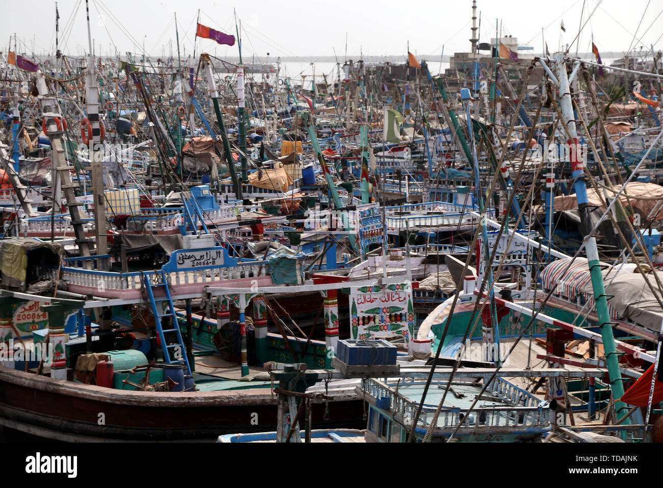 Karachi, Pakistan. 14th June, 2019. Fishing boats are anchored at the Karachi harbor in Karachi, southern Pakistan, on June 14, 2019. The Pakistan Meteorological Department has issued a red alert warning regarding the tropical cyclone 'Vayu' and heatwave for the country's southern Sindh province, local reports said on Thursday. Credit: Stringer/Xinhua/Alamy Live News - Stock Image