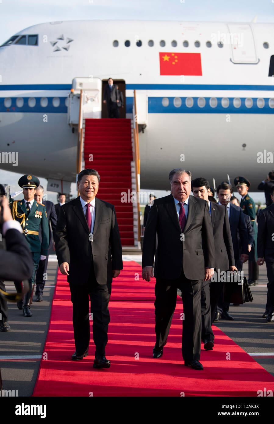 Dushanbe, Tajikistan. 14th June, 2019. Chinese President Xi Jinping (L) is warmly received by Tajik President Emomali Rahmon upon his arrival at the airport in Dushanbe, Tajikistan, June 14, 2019. Xi arrived here Friday for the fifth summit of the Conference on Interaction and Confidence Building Measures in Asia (CICA) and a state visit to Tajikistan. Credit: Sadat/Xinhua/Alamy Live News - Stock Image