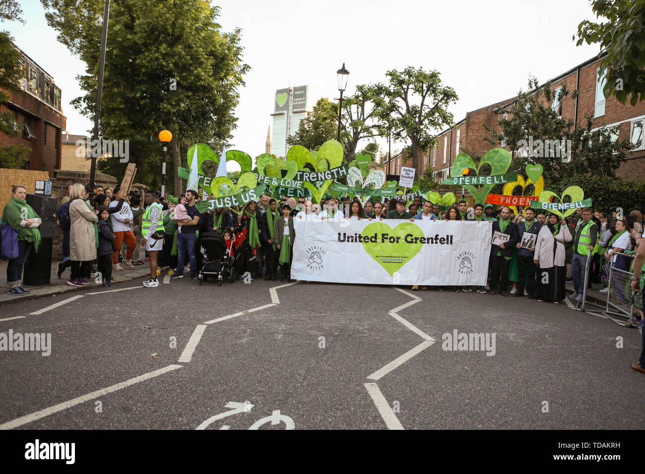 London, UK. 14th June, 2019. Members from the Grenfell community, with local fire fighters, take part in the Grenfell Silent Walk to mark the 2nd anniversary of the tower block fire in 2017 when 72 people lost their lives. Penelope Barritt/Alamy Live News - Stock Image