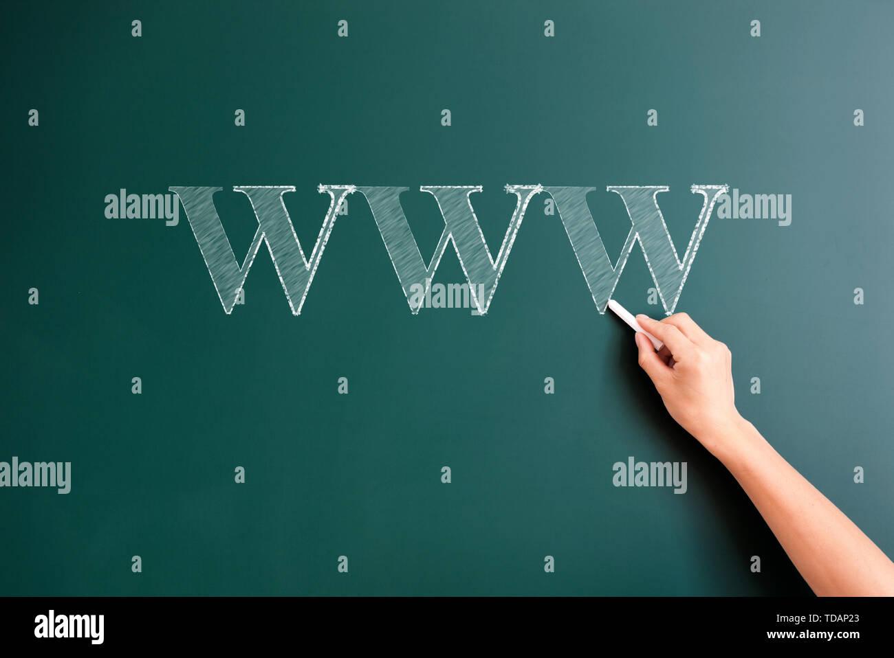 www written on blackboard - Stock Image