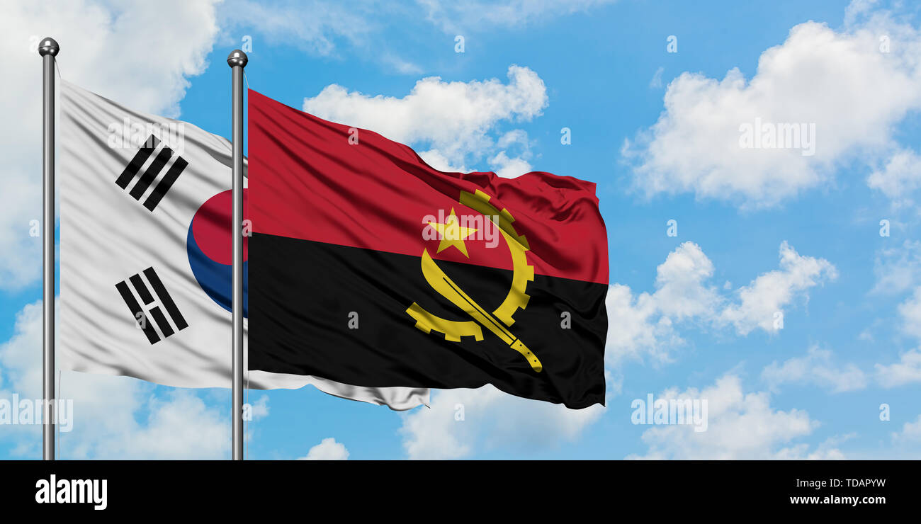 South Korea and Angola flag waving in the wind against white cloudy blue sky together. Diplomacy concept, international relations. - Stock Image