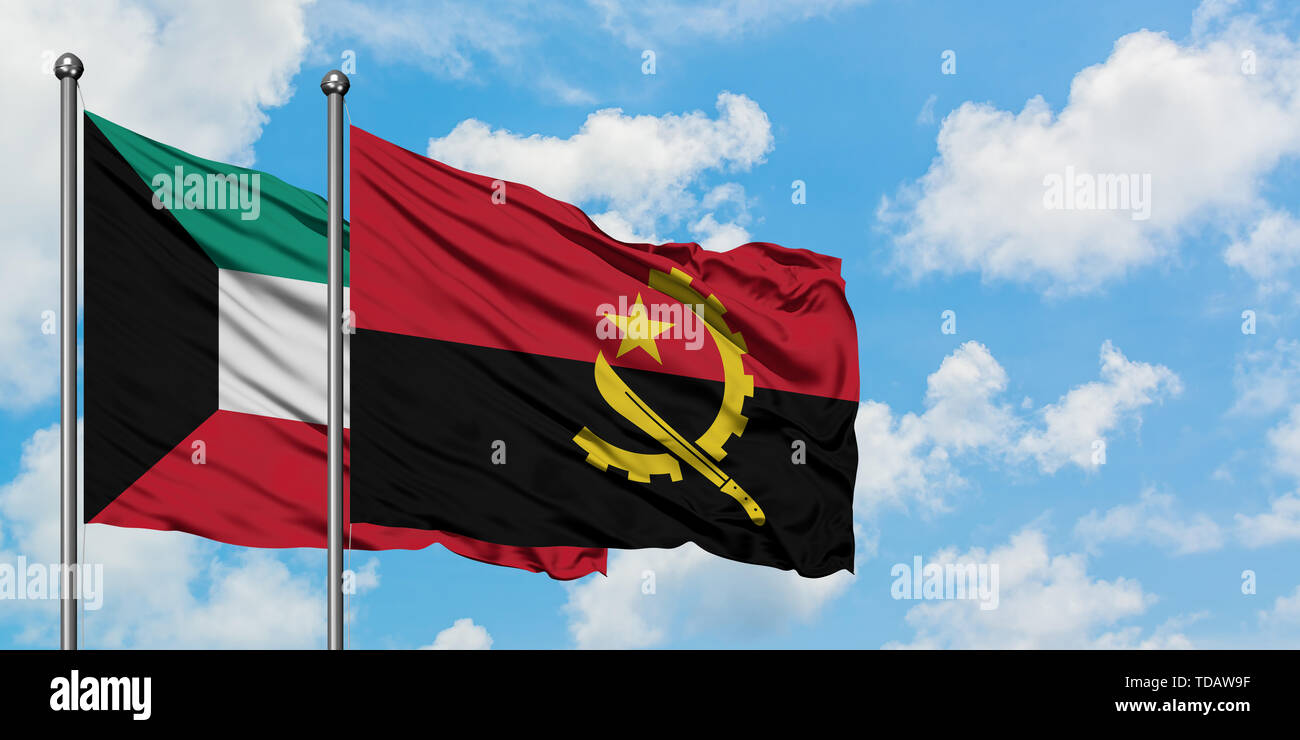 Kuwait and Angola flag waving in the wind against white cloudy blue sky together. Diplomacy concept, international relations. - Stock Image