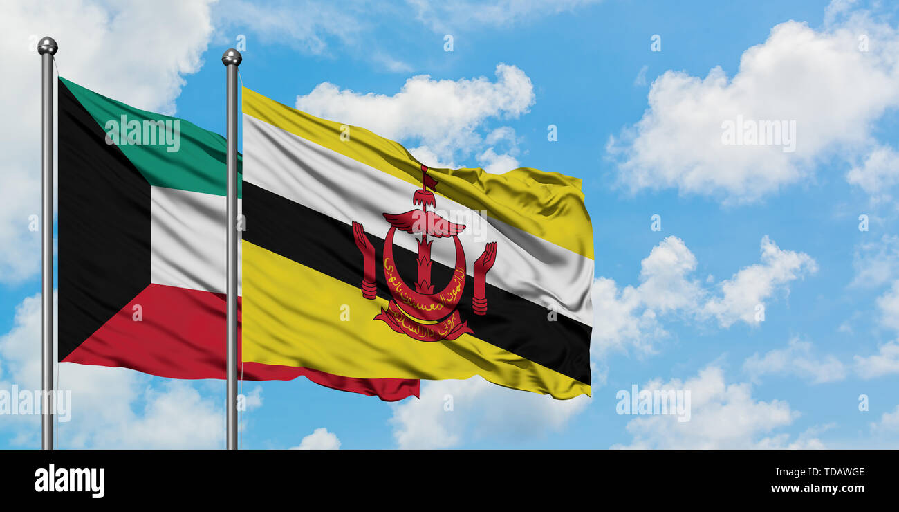 Kuwait and Brunei flag waving in the wind against white cloudy blue sky together. Diplomacy concept, international relations. - Stock Image