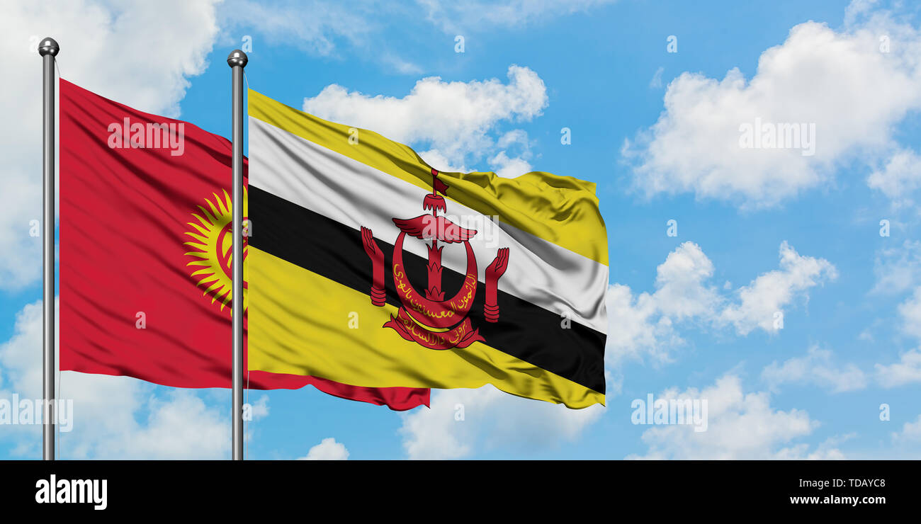 Kyrgyzstan and Brunei flag waving in the wind against white cloudy blue sky together. Diplomacy concept, international relations. - Stock Image
