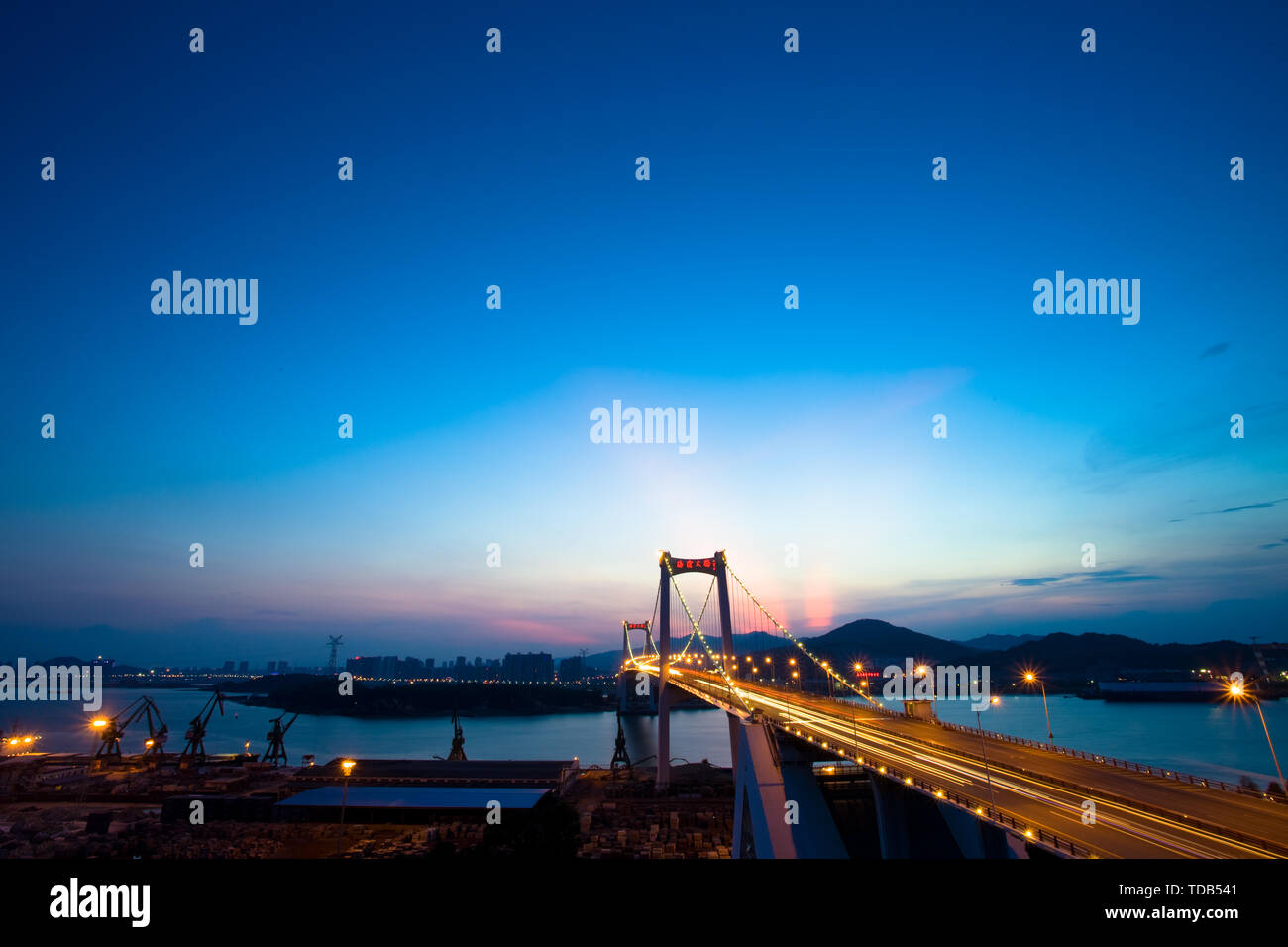 bridge over sea at night in xiamen - Stock Image