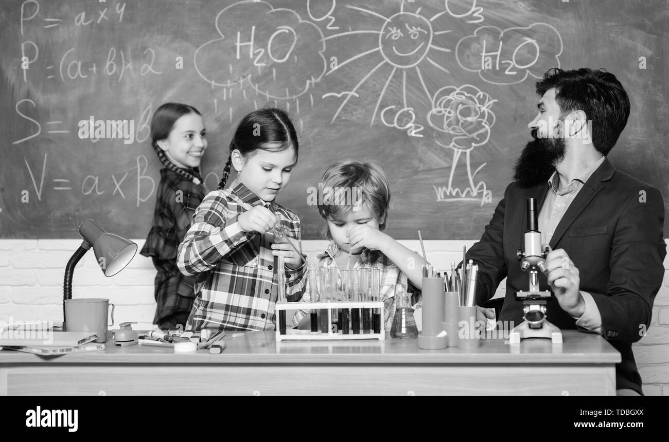 Science is always the solution. Observe reaction. School chemistry experiment. Fascinating chemistry lesson. Man bearded teacher and pupils with test tubes in classroom. Explaining chemistry to kids. - Stock Image