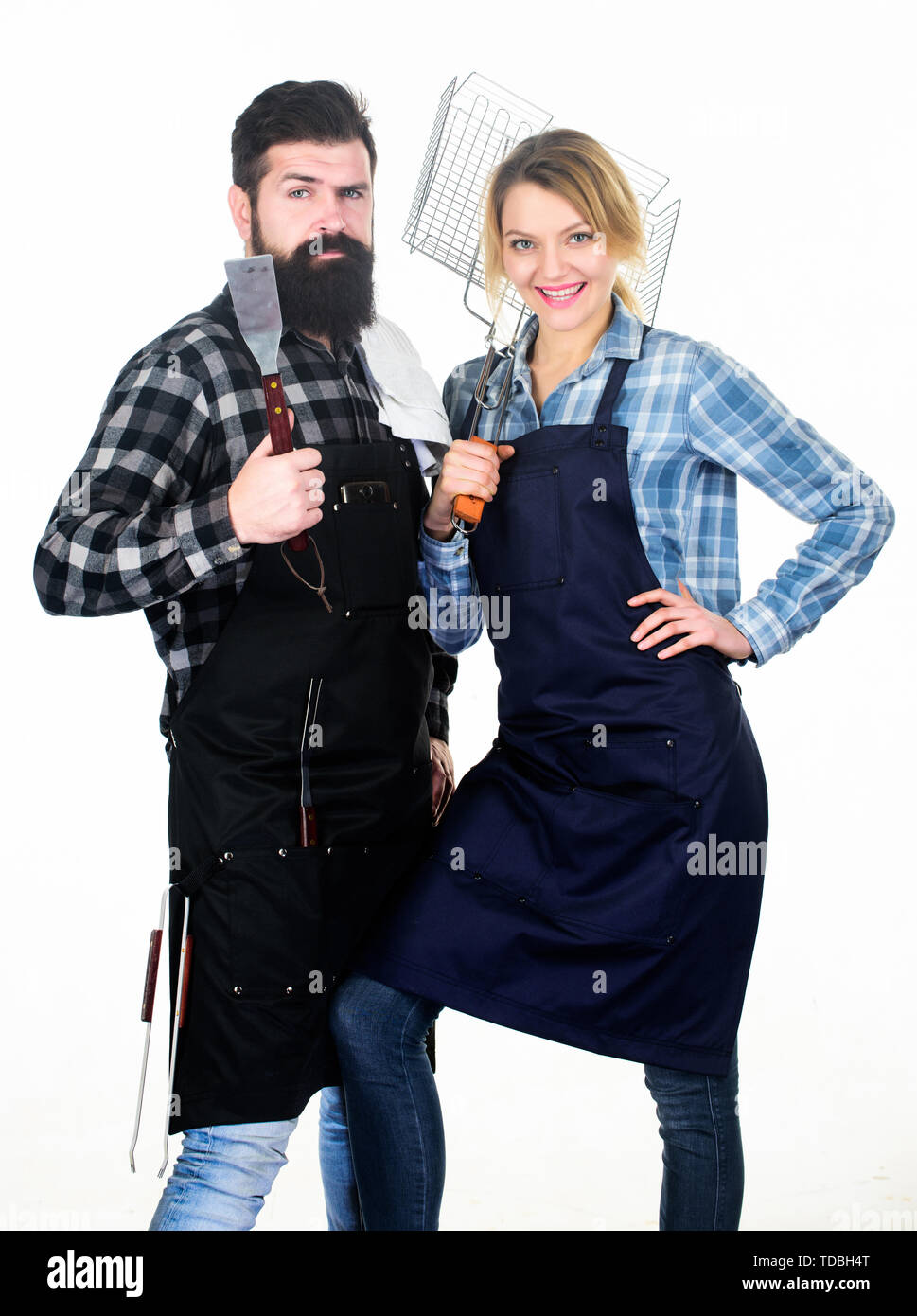 Kitchen equipment. Family weekend. Couple in love hold kitchen utensils. Man bearded hipster and girl. Preparation and culinary. Tools for roasting meat. Picnic barbecue. food cooking recipe. - Stock Image