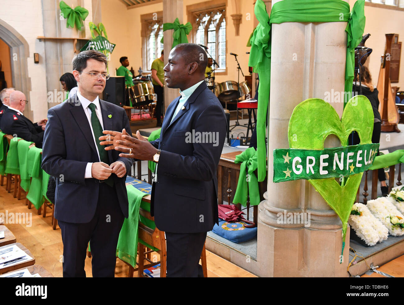 Housing Secretary James Brokenshire (left)attends a service of remembrance at St Helens church, London, to mark the two-year anniversary of the Grenfell Tower block fire. - Stock Image