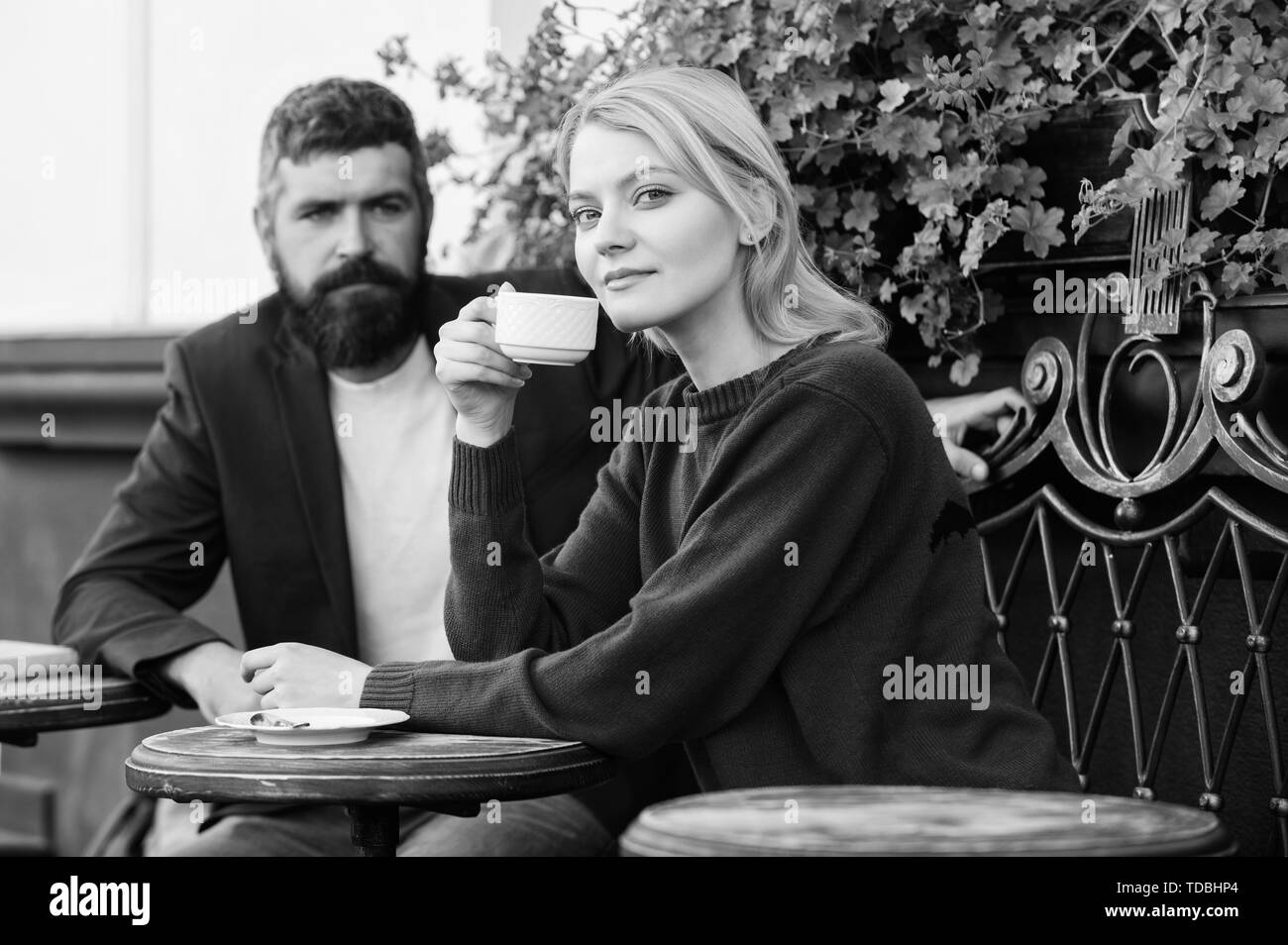 Couple terrace drinking coffee. Casual meet acquaintance public place. Meeting people first date. Strangers meet become acquaintances. Apps normal way to meet and connect with other single people. - Stock Image