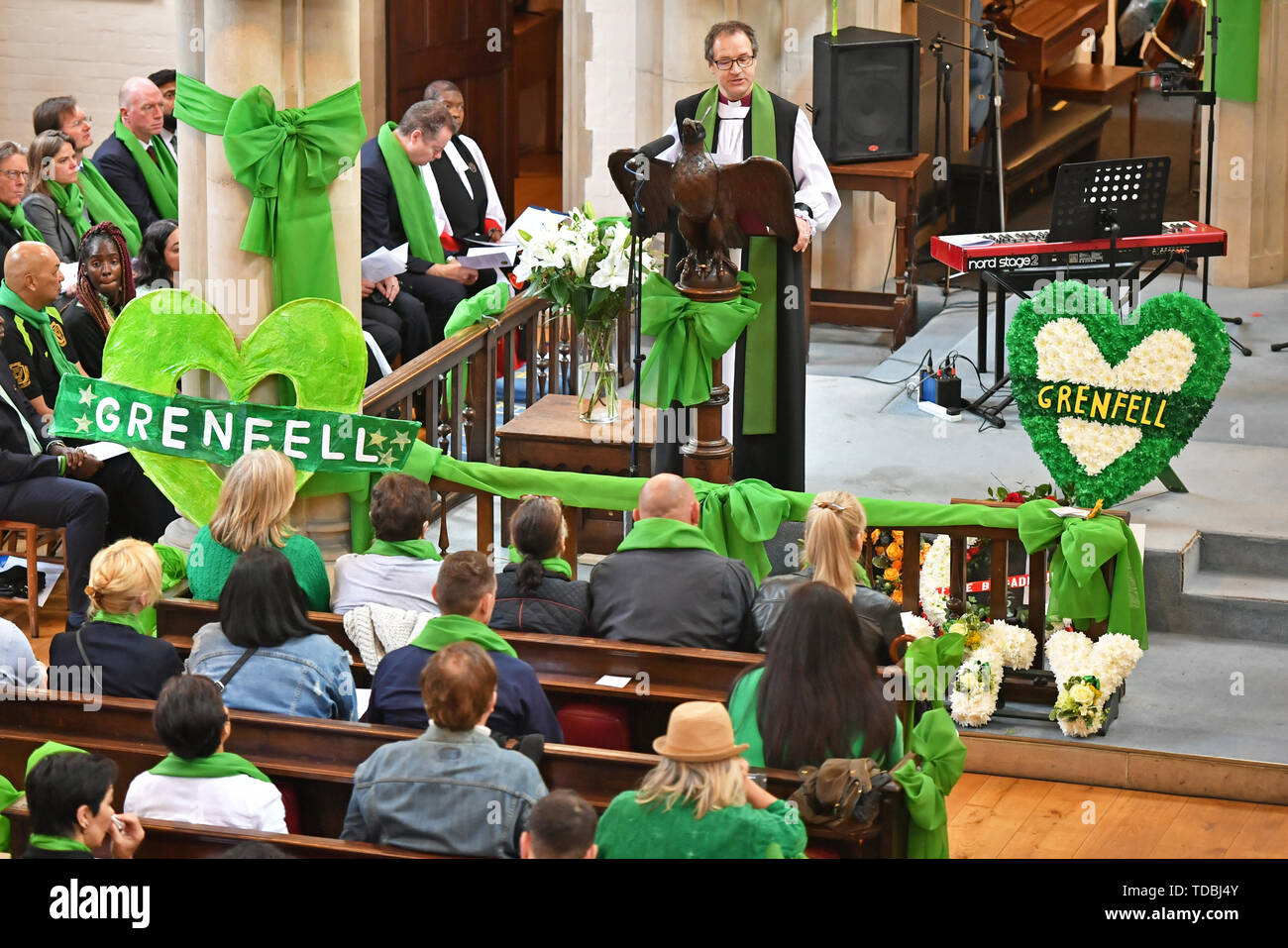Dr Graham Tomlin, the Bishop of Kensington, speaks at a service of remembrance takes place at St Helens church, London, to mark the two-year anniversary of the Grenfell Tower block fire. - Stock Image