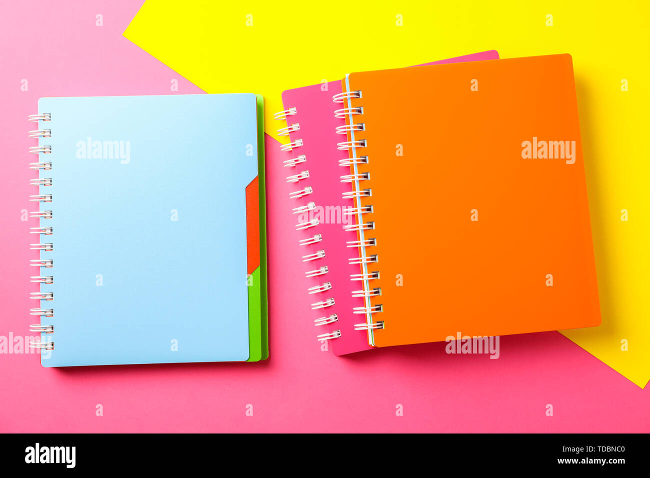 Composition with copybooks on two tone background, space for text - Stock Image