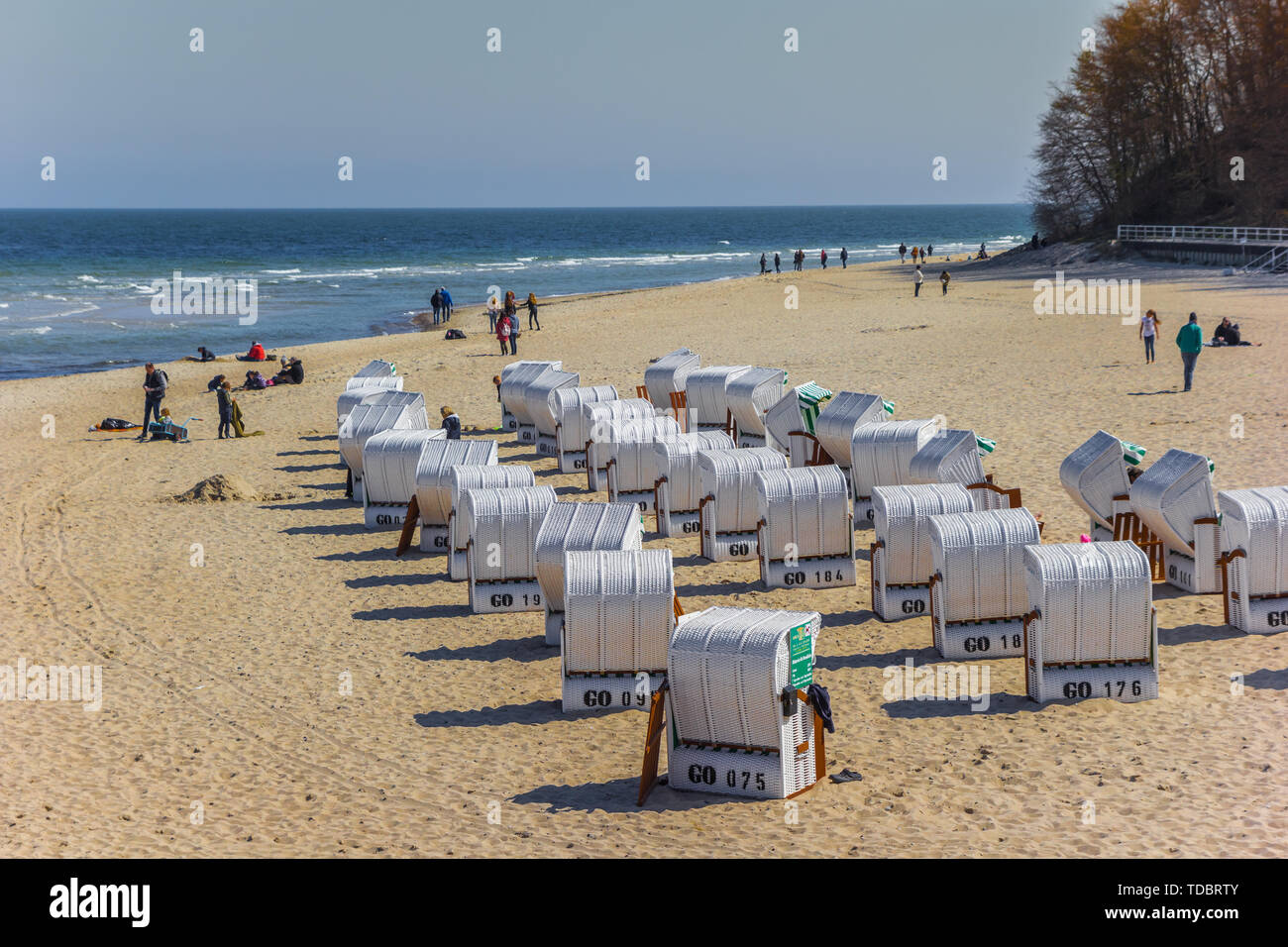 Traditional Strandkorbe chairs on the beach of Sellin on Rugen island, Germany - Stock Image