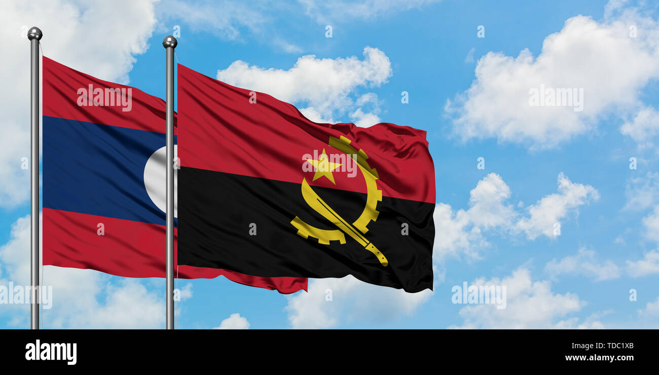 Laos and Angola flag waving in the wind against white cloudy blue sky together. Diplomacy concept, international relations. - Stock Image