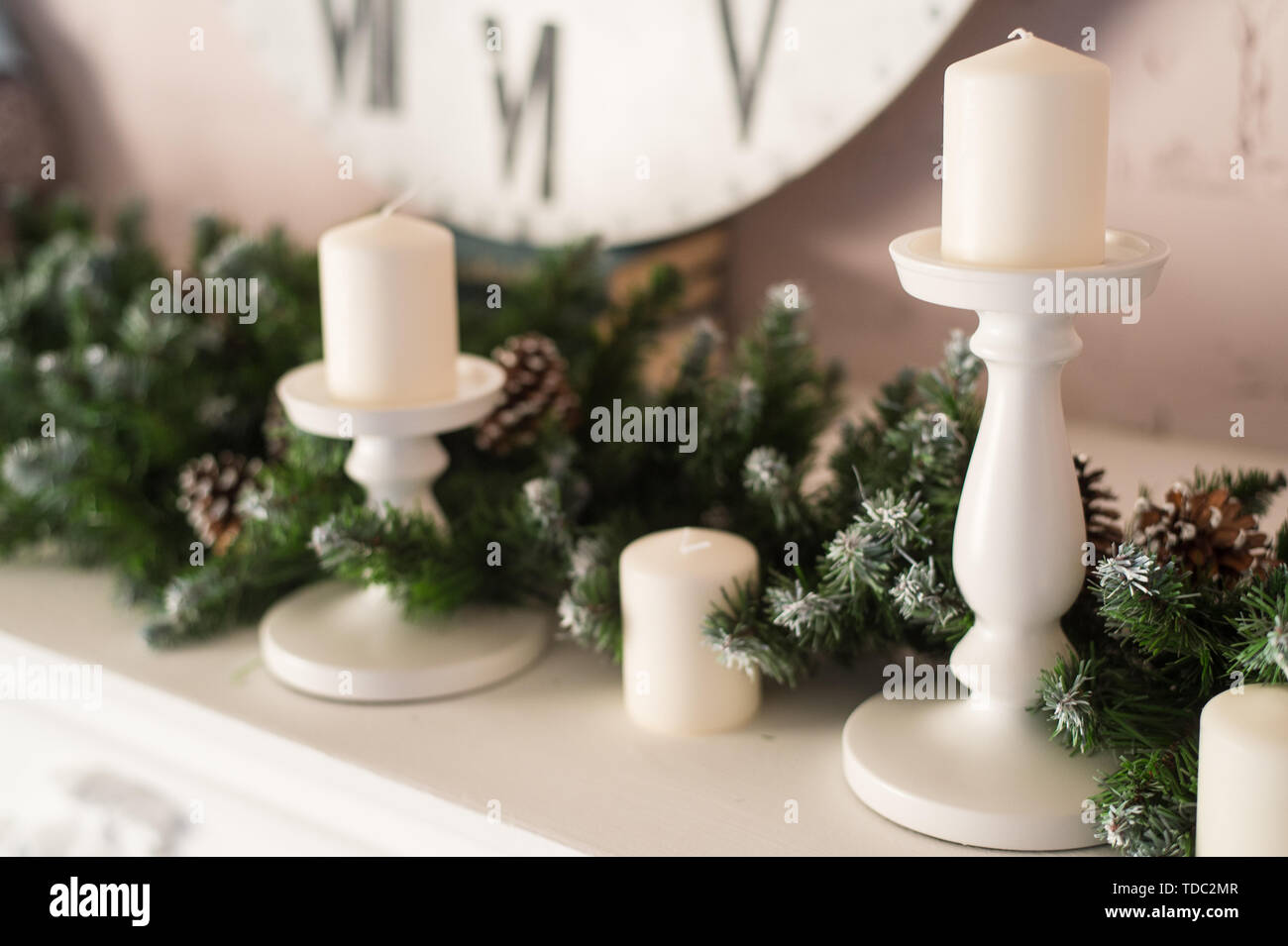 Decor Fireplace Candles Clock Face And Fir Branches Close Up