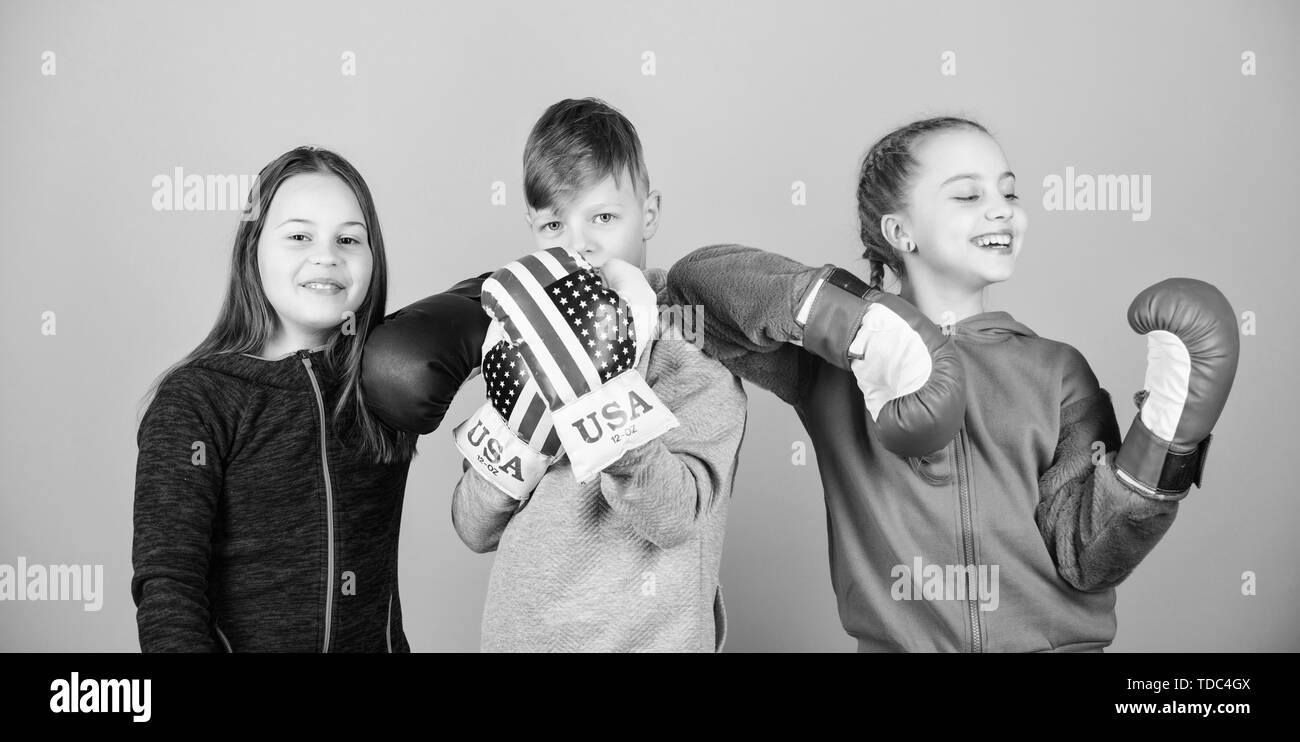 Happy children in boxing gloves. Fitness diet. energy health. punching knockout. Childhood activity. Sport success. Team fight. workout of small girls and boy boxer in sportswear. Pure perfection. - Stock Image