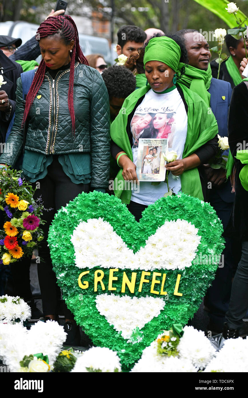People gather outside St Helens church, London, following a service to mark the two-year anniversary of the Grenfell Tower block fire. - Stock Image
