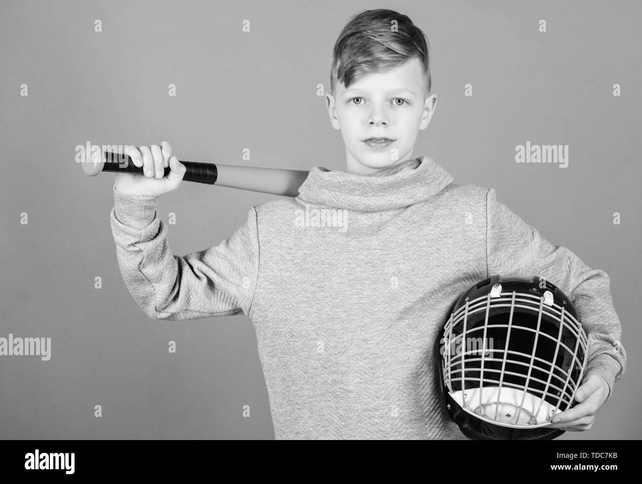Gym workout of teen boy. Fitness diet brings health and energy. Baseball bat and helmet. Success. Childhood activity. Sport game. child sportsman. Confident baseball player. Boy on baseball stadium. Stock Photo