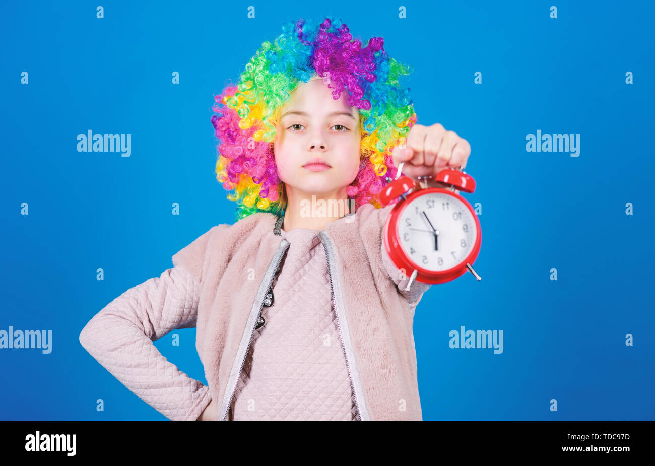 Punctuality is a kingly virtue. Cute little child demanding punctuality. Adorable small girl strictly observing punctuality. Punctuality concept. - Stock Image