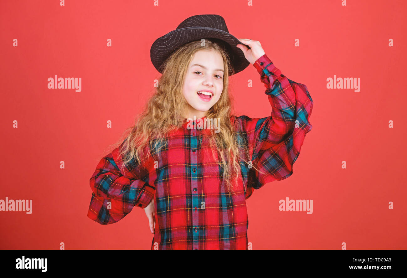 Develop talent into career. Enter acting academy. Girl artistic kid practicing acting skills with black hat. Acting school for children. Acting lessons guide children through wide variety of genres. - Stock Image