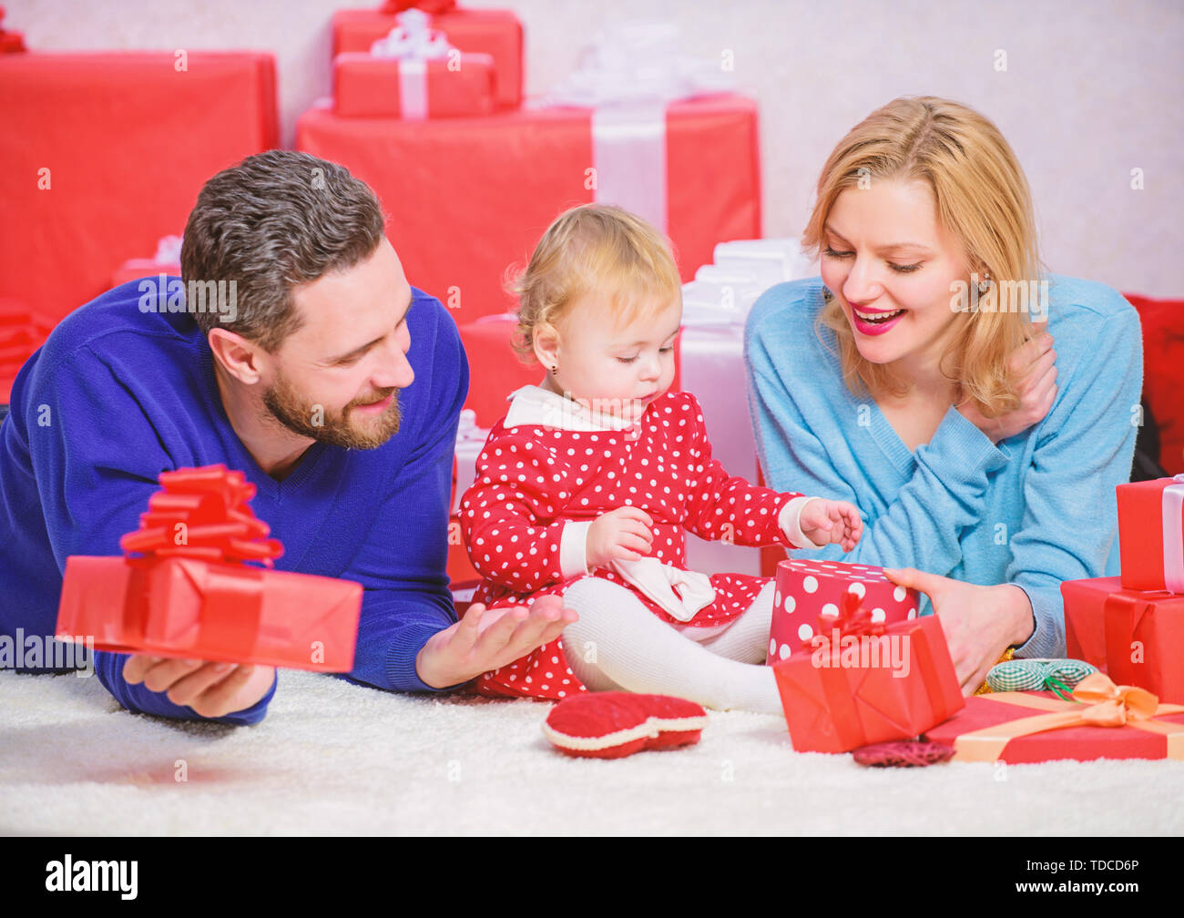 Couple in love and baby are happy family. Celebrating something special. Traditional family values. Family celebrate anniversary. Valentines day. Lovely family celebrate valentines day. Happy parents. - Stock Image