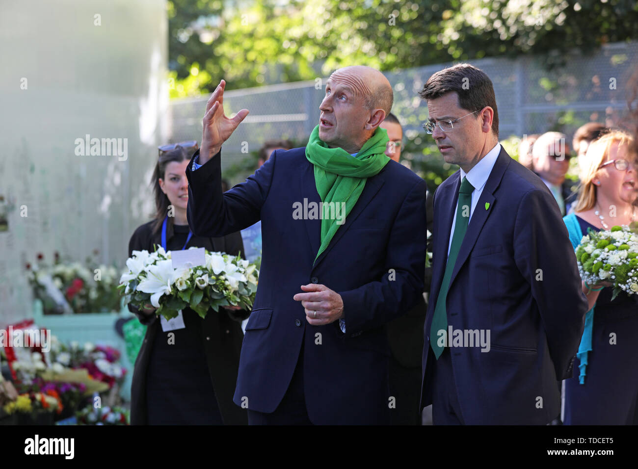 Shadow housing secretary John Healey (left) outside Grenfell Tower, London, ahead of the wreath laying ceremony, to mark the two-year anniversary of the tower block fire in memory of the 72 people who lost their lives. - Stock Image