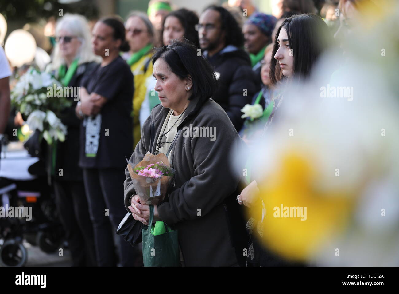 Family and friends of the 72 people who lost their lives in the Grenfell Tower block fire lay wreaths outside Grenfell Tower, London, to mark the two-year anniversary. - Stock Image